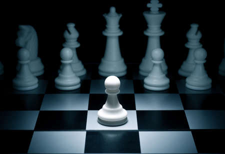 Chess. White go the first. The central figure-pawn photo
