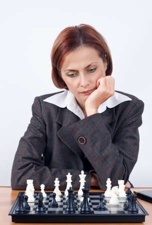 The business woman plays chess photo