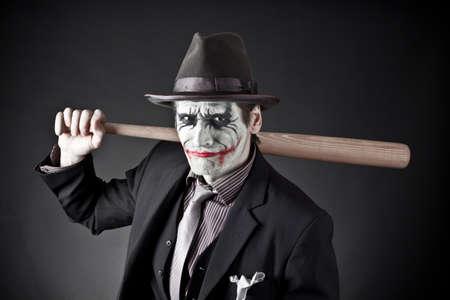 人の手の中の野球のバットでモンスターの類似性に 写真素材