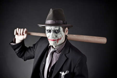 insane insanity: The person on similarity of the monster with a baseball bat in hands Stock Photo