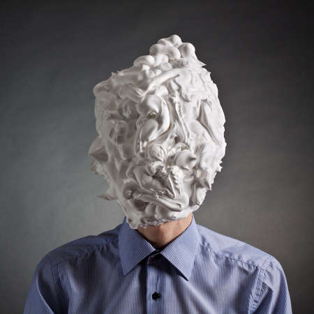 The man with foam for shaving on a head photo