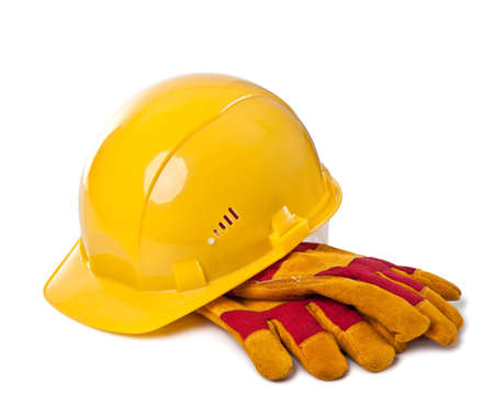 Building helmet and protective gloves on the isolated white background
