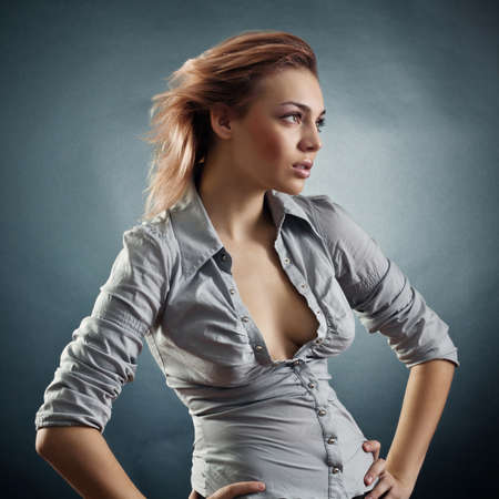 Portrait of the young woman against a dark background Stock Photo - 12005541