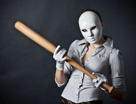 anonymous: The teenager in a mask and with a bat