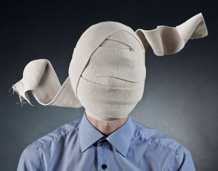 Portrait of the man with elastic bandage on a head photo