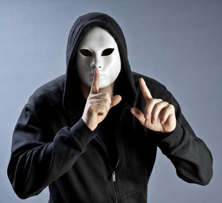 quiet adult: The person in a mask calls for silence Stock Photo