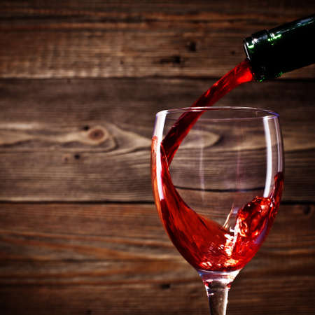 red wine flows in a glass Stock Photo - 13492803