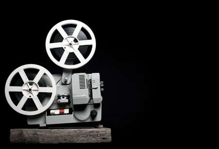 Old film projector on a black backgroun photo