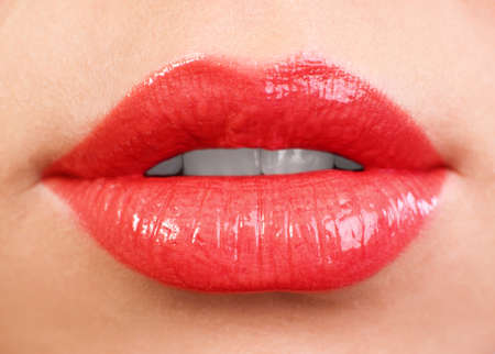 Female lips close up. Red color photo
