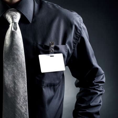 name tags: Manager.  Badge at the forefront