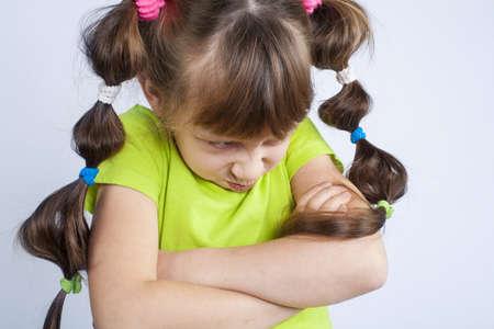 yuck: Very upset little girl Stock Photo