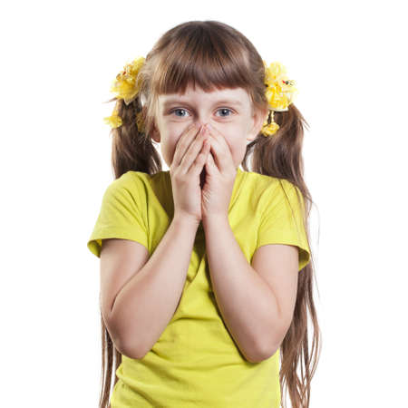 hand covering eye: Portrait of a child. Girl playfully covered her mouth and nose with his hands Stock Photo