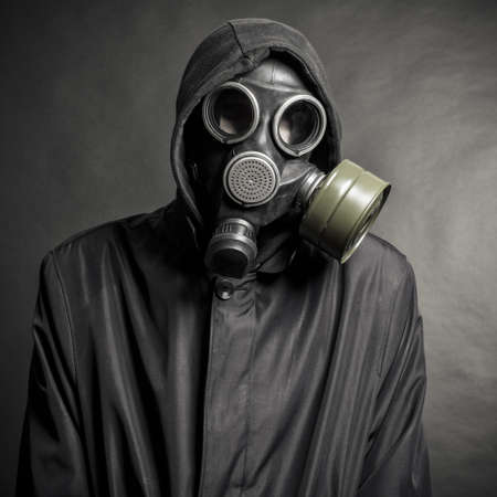 A man in a gas mask on a black background Stock Photo - 15831804