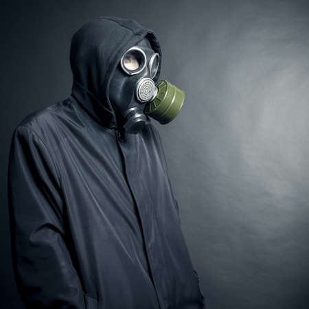 A man in a gas mask on a black background photo