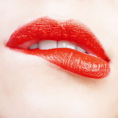 Young woman bit her lower lip Lips closeup  Red color