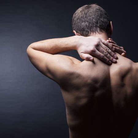 Pain neck. The back man.Black background