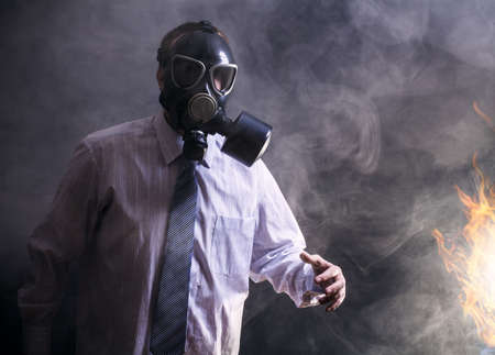 a man in a gas mask goes through the smoke photo