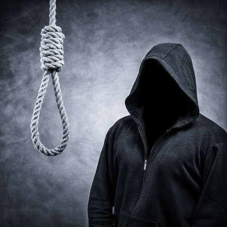 Noose and the invisible man in the hood.Background in smoke Stock Photo
