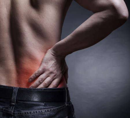pressure massage: Backache. Pain in the lower back. Mans back Stock Photo