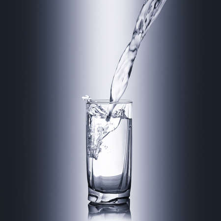 purified: Glass of pure spring water Stock Photo