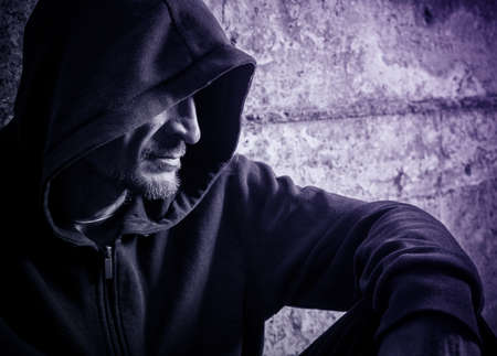 solitariness: Portrait of a lonely man in a hood
