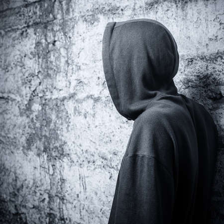 solitariness: Man in a hooded sweatshirt  View from the back