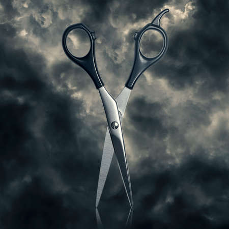 snip: scissors for cutting hair against the leaden clouds