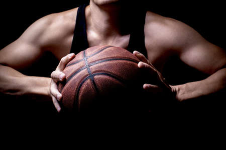athlete: An athlete getting ready to throw a basketball into the basketball hoop