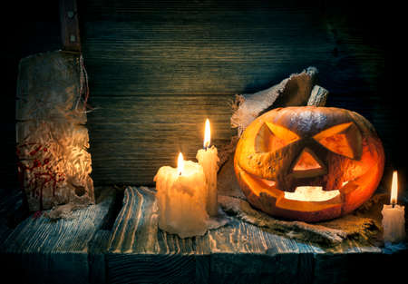 Scarved jack-o-lantern on a wooden background Stock Photo - 23280800