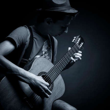 Young man playing the guitar Stock Photo - 23280791