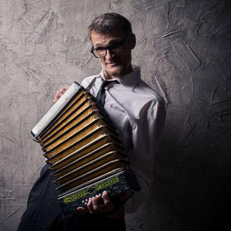 eccentric: temperamental man plays the accordion
