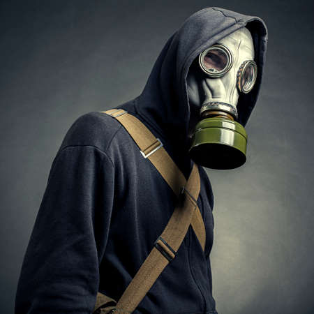 A man in a gas mask on a dark background