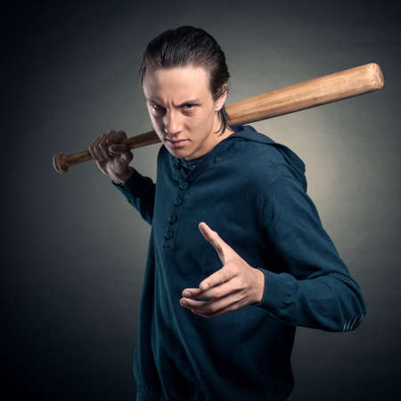 expresses: A young man with a bat expresses claim
