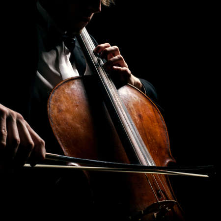 cellist on a black background photo