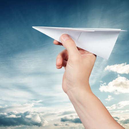 Paper plane against the blue sky