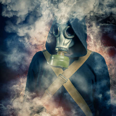 shrouded: A man in a gas mask shrouded in smoke