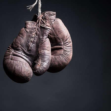 leather glove: vintage boxing gloves on a  black background