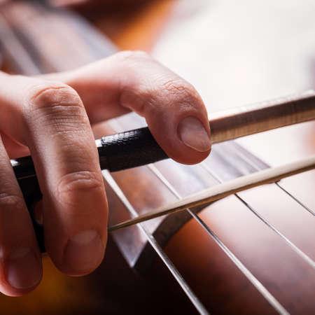 fiddlestick: fiddlestick in hand cellist closeup