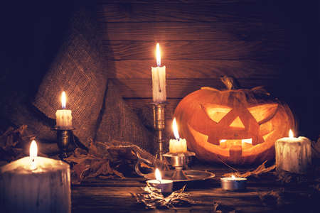 halloween background: Pumpkin around burning candles