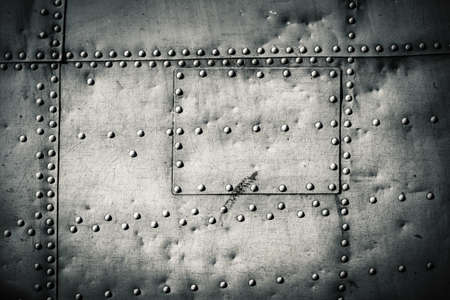 rivets on a metal plate