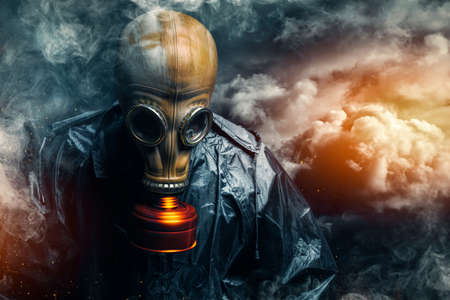 dramatic portrait of a man wearing a gas mask