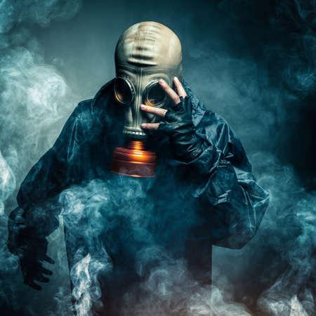 dramatic portrait of a man wearing a gas mask photo
