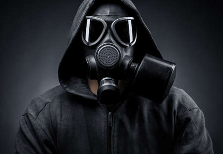 male in a gas mask on a dark background photo