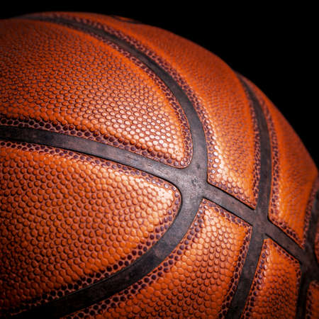 sport object: basketball ball on a black background