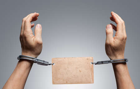 culprit: Male hands in handcuffs.Place for text Stock Photo