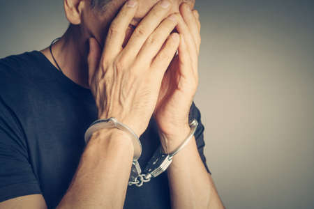 male hands in handcuffs photo