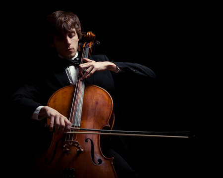 cellos: musician playing the cello. Black background Stock Photo