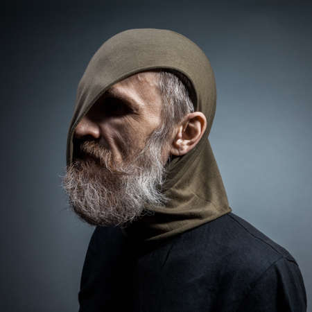 Portrait of a bearded man.Side view photo