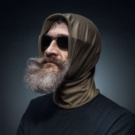 Portrait of a bearded man wearing sunglasses photo