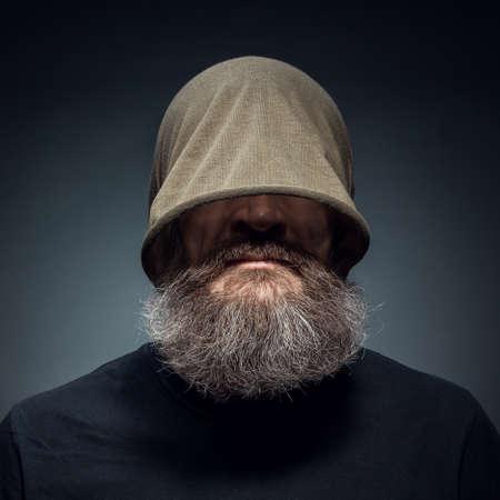 Portrait of a bearded man with a mushroom cap on his head photo